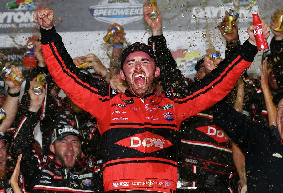 Austin Dillon and his pit crew let it all hang in Victory Lane after winning Sunday's season-opening NASCAR Cup race. Photo: Sarah Crabill, Stringer / 2018 Getty Images