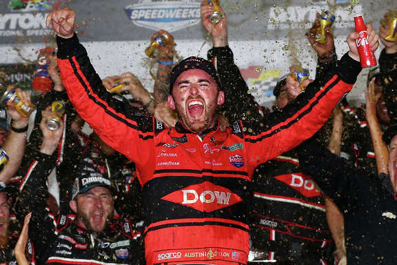 Austin Dillon and his pit crew let it all hang in Victory Lane after winning Sunday's season-opening NASCAR Cup race.