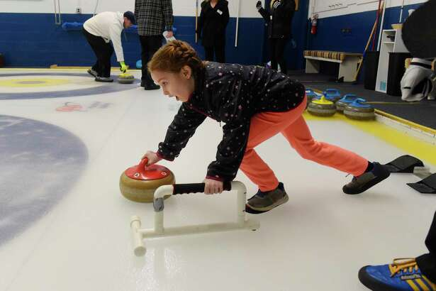 Mollie Grebert, 6, of Troy learns the sport of curling at the Winter Olympic open house at Albany Curling Club on Sunday, Feb. 18, 2018, in Albany, N.Y.   (Paul Buckowski/Times Union)