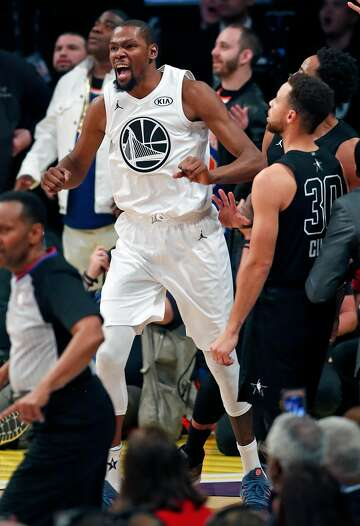 f4db3dd17a9 1of32Team LeBron s Kevin Durant and Team Stephen s Stephen Curry react to  Team LeBron s 148-145 win during NBA All Star Game at Staples Center in Los  ...