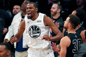 Team LeBron's Kevin Durant and Team Stephen's Stephen Curry react to Team LeBron's 148-145 win during NBA All Star Game at Staples Center in Los Angeles, Calif., on Sunday, February 18, 2018.