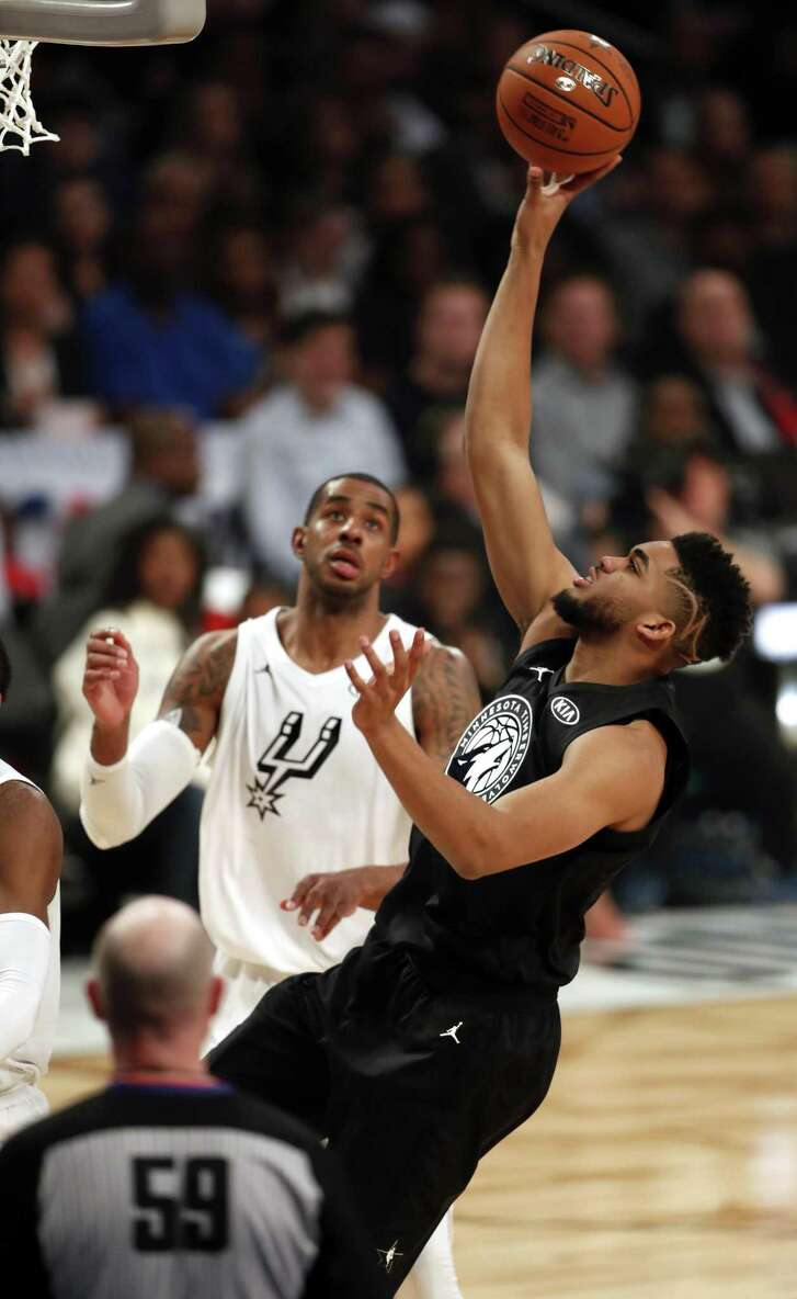 Team Stephen's Karl-Anthony Towns scores against Team LeBron's LaMarcus Aldridge in 1st quarter during NBA All Star Game at Staples Center in Los Angeles, Calif., on Sunday, February 18, 2018.