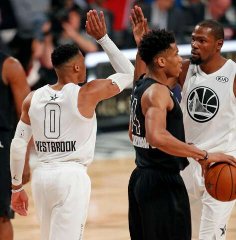 detailed look c0599 f2cb3 Team LeBron s Kevin Durant and Russell Westbrook high five during 148-145  win over Team