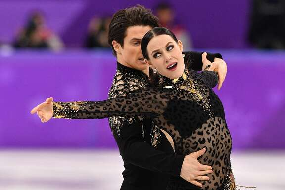 Canada's Tessa Virtue and Canada's Scott Moir compete in the ice dance short dance of the figure skating event during the Pyeongchang 2018 Winter Olympic Games at the Gangneung Ice Arena in Gangneung on February 19, 2018. / AFP PHOTO / Mladen ANTONOVMLADEN ANTONOV/AFP/Getty Images