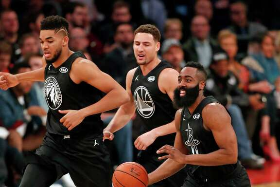 Rockets guard James Harden, from right, leads Klay Thompson and Karl-Anthony Towns in an upcourt charge against Team LeBron in the second quarter of the NBA All Star Game at Staples Center in Los Angeles on Sunday night.