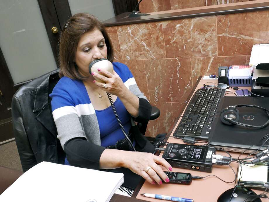 Blanca Hill demonstrates the device used to record a trial. Photo: Cuate Santos / Laredo Morning Times / Laredo Morning Times