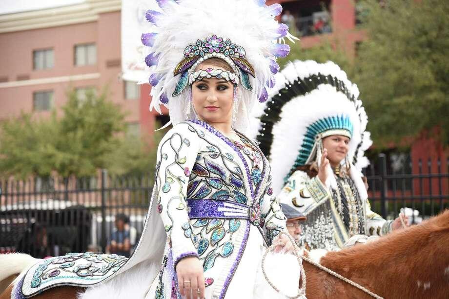 Participants in Native American regalia ride their horses during the WBCA Parade on San Bernardo Avenue on Saturday. Photo: Christian Alejandro Ocampo / Laredo Morning Times / Laredo Morning Times