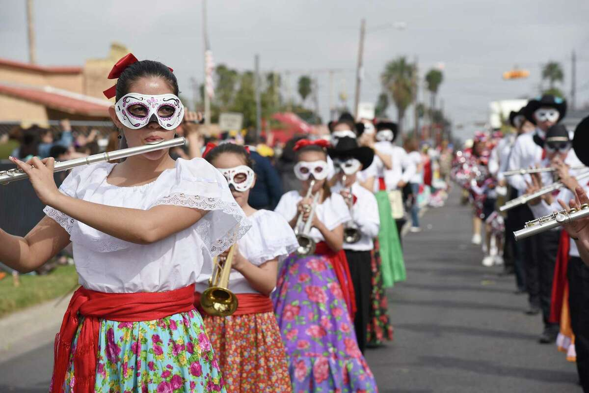 Students from Nuevo Laredo perform as they walk down the avenue during the WBCA Parade on San Bernardo Avenue on Saturday