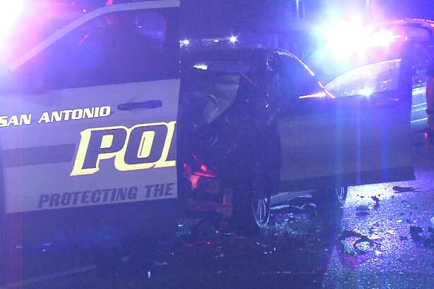 A San Antonio police officer was rear-ended by a woman after he helped pull over a wrong way driver on Feb. 19, 2018.