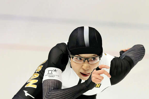 Japan's Nao Kodaira skates to victory in the women's 500 meters in Olympic-record time on February 18, 2018.