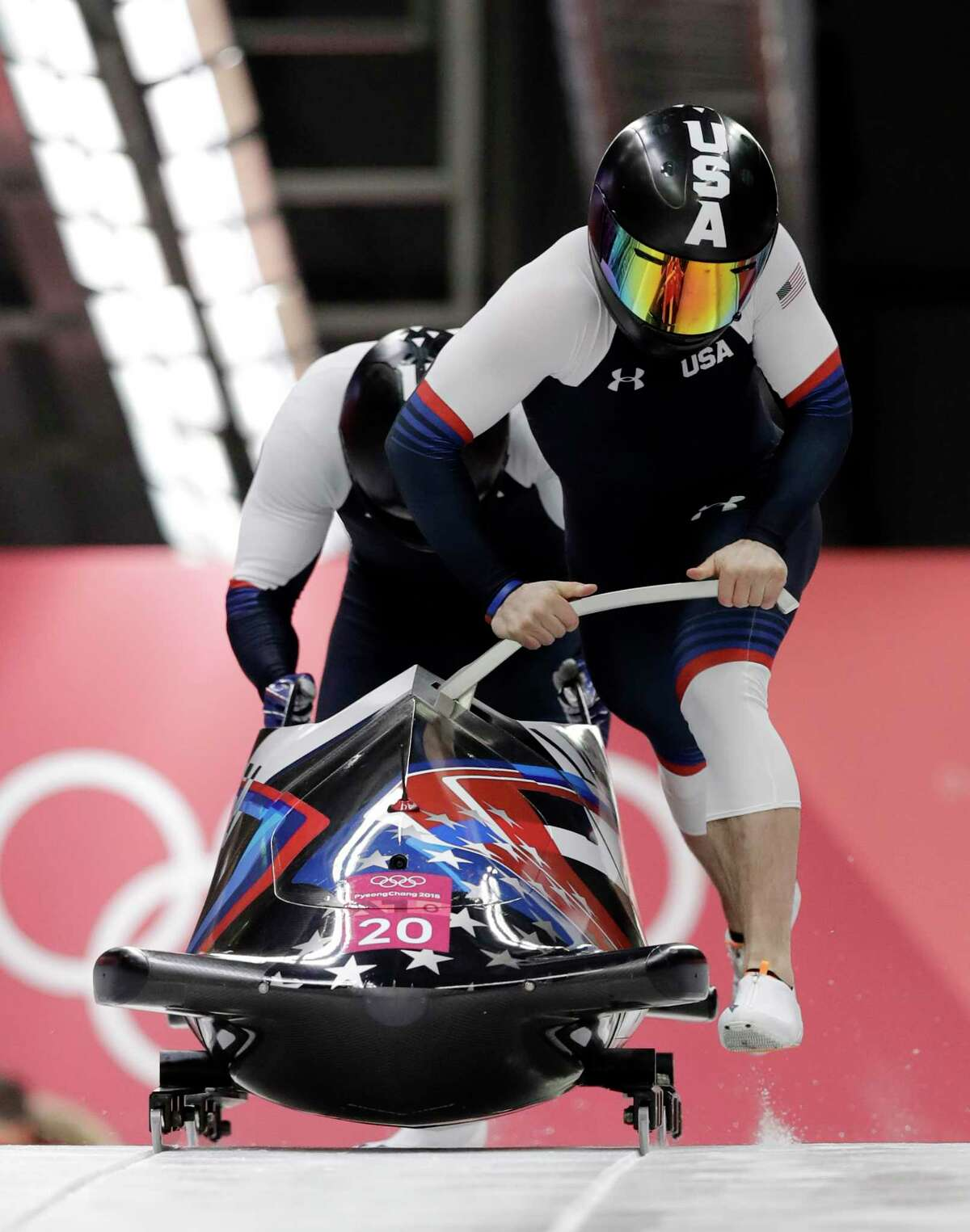 Driver Codie Bascue and Samuel McGuffie of the United States starts their third heat during the two-man bobsled final at the 2018 Winter Olympics in Pyeongchang, South Korea, Monday, Feb. 19, 2018. (AP Photo/Wong Maye-E)