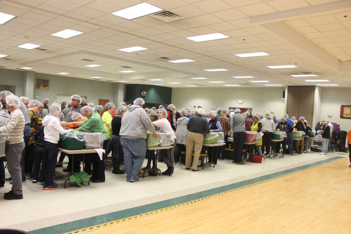 In an effort spearheaded by the Edwardsville Rotary Club, approximately 130 volunteers gathered Saturday morning to package meals for shipment to Nicaragua. Over the course of about three hours, 25,000 meals were prepared at the Edwardsville Moose Lodge.