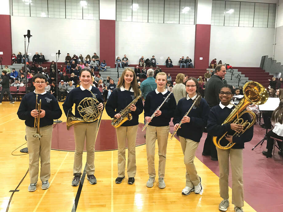 Six members of the Edwardsville Catholic Schools Band representing St. Boniface and St. Mary's schools were selected to participate in the Madison County Band Directors Association Honor Band Festival on February 10.  The best band students from all over Madison County were nominated and then selected in November of 2017 by their band directors. After preparing their music, students rehearsed the afternoon of Feb. 10 with guest conductors, Dennis McFarland and Mark Donahue, at Collinsville Middle School culminating in a concert that evening given for their familyand friends. From left are: Jesse Hattrup (St. Mary's), Abby Johnes (St. Boniface), Ellie Hyten (St. Boniface), Elaina Jensen (St. Mary's), Sarah Brase (St. Boniface) and Elizabeth Jones (St. Boniface). Photo: Bill Tucker • Btucker@edwpub.net