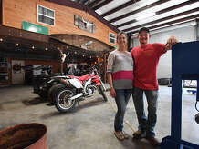 Brian Curtis and Jenifer Curtis at their SIlsbee Barndominium on Friday. Classified as a residence, the structure consists of a home inside a workshop and is a rising trend of home ownership.  Photo taken Friday, February 16, 2018 Guiseppe Barranco/The Enterprise