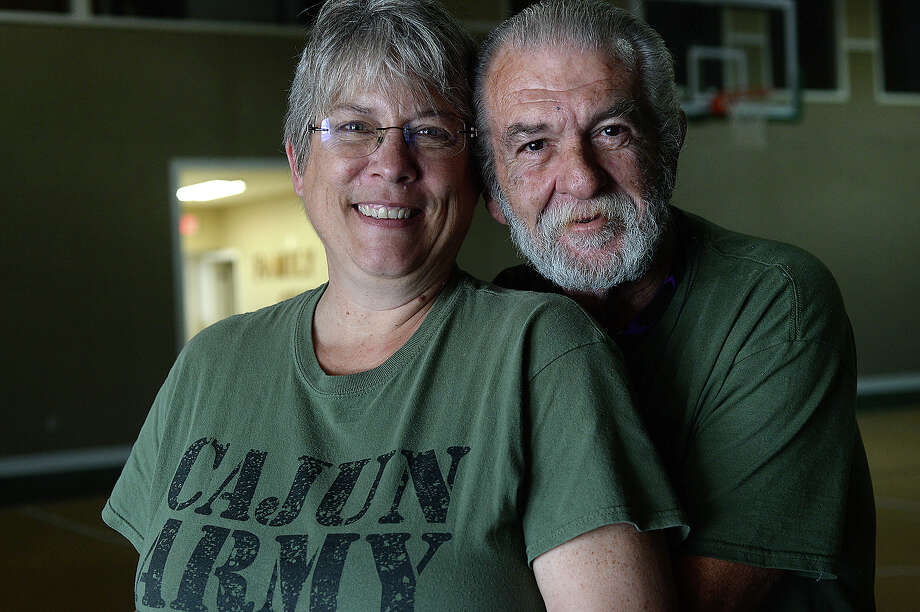 Patty and Richard Gibbs never may have met had it not been for Tropical Storm Harvey. Patty, a Michigan resident and Richard, an officer with the St. John Parrish Sheriff Department in Louisiana, both came to Southeast Texas after Harvey struck, and began working with a Cajun Army group based at First Batist Church in Hamshire, to help those affected. Both were immediately interested in each other, but their volunteer work demanded full attention. When Patty went home to go back to work, the two kept in touch, and when Richard visited her for Christmas, the gift hidden among the presents under the tree was an engagement ring. The couple were married this year in Judge Baylor Wortham's courtroom when Patty came back to volunteer for another stint. Photo taken Thursday, February 15, 2018 Kim Brent/The Enterprise Photo: Kim Brent / BEN