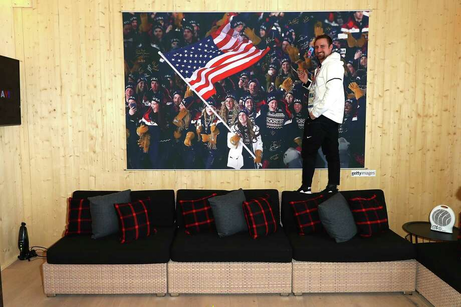 U.S. Olympian Joe Polo signs the athlete wall at the USA House at the 2018 Winter Olympic Games in South Korea. A reader is heartened that U.S. athletes are honoring the flag. Photo: Joe Scarnici /Getty Images For USOC / 2018 Getty Images