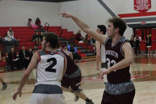 Tarkington Longhorn Bryson LeBlanc (32) makes a shot over the head of an opposing Huffman Falcon during the Feb. 13 basketball game.