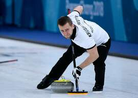 Photo dated on February 8, 2018 shows Russia's Aleksandr Krushelnitckii brushes the ice surface during the curling mixed doubles round robin session between the US and the Olympic Athletes from Russia during the Pyeongchang 2018 Winter Olympic Games at the Gangneung Curling Centre in Gangneung. The Court of Arbitration for Sport said it had opened an anti-doping case against Russian curler Alexander Krushelnitsky on February 19, 2018. / AFP PHOTO / WANG ZhaoWANG ZHAO/AFP/Getty Images