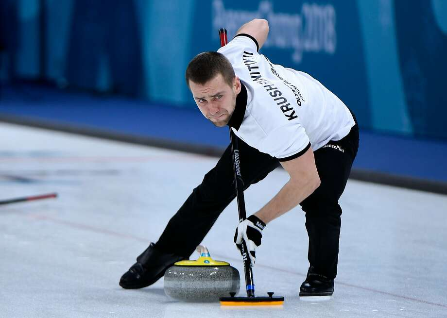 Photo dated on February 8, 2018 shows Russia's Aleksandr Krushelnitckii brushes the ice surface during the curling mixed doubles round robin session between the US and the Olympic Athletes from Russia during the Pyeongchang 2018 Winter Olympic Games at the Gangneung Curling Centre in Gangneung. The Court of Arbitration for Sport said it had opened an anti-doping case against Russian curler Alexander Krushelnitsky on February 19, 2018. Photo: WANG ZHAO, AFP/Getty Images