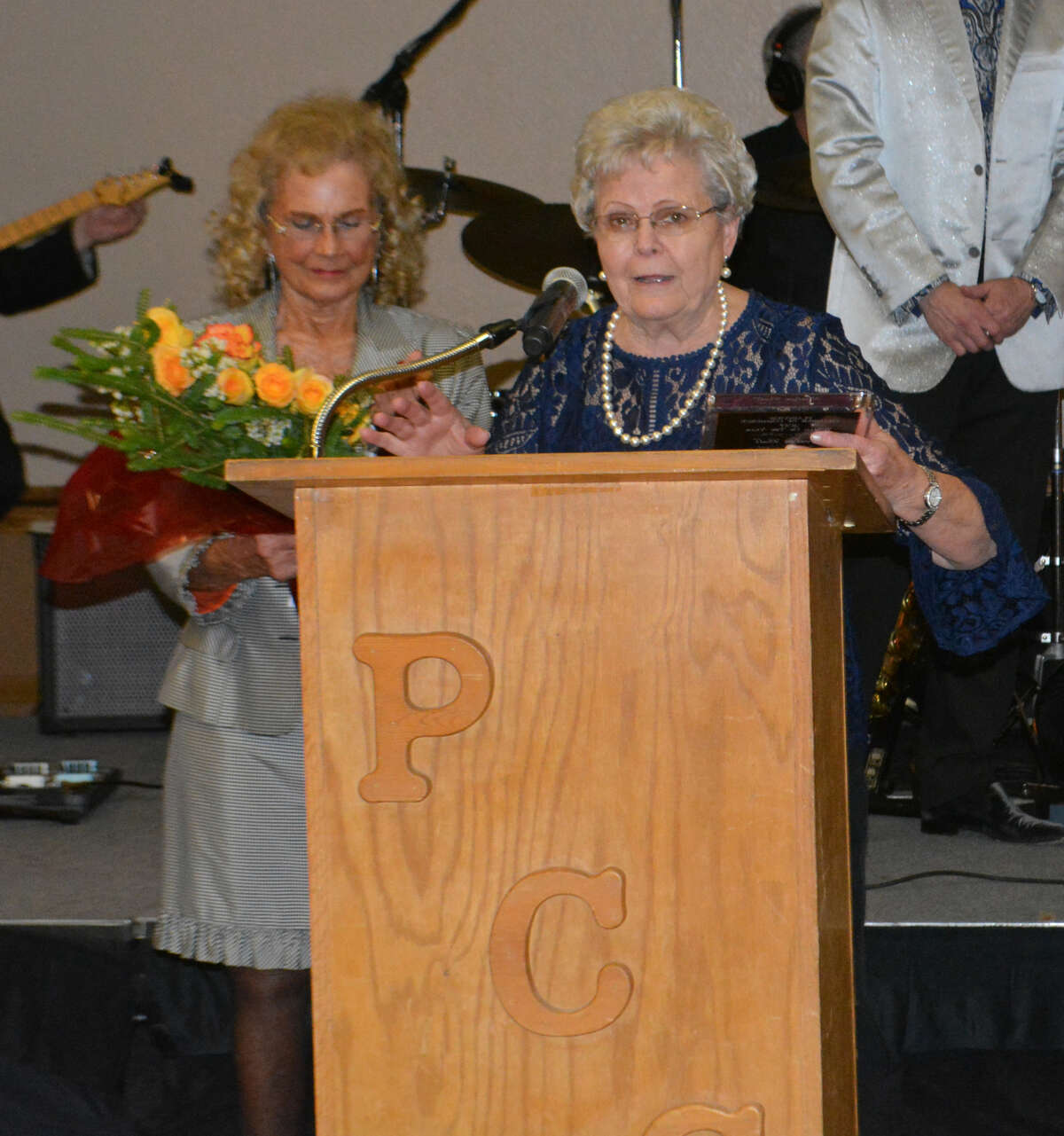 2017 Woman of the Year Evelyn Ball speaks to the assembled crowd at the Plainview Chamber of Commerce's annual banquet Thursday while 2016 Woman of the Year Norvene Owen looks on.