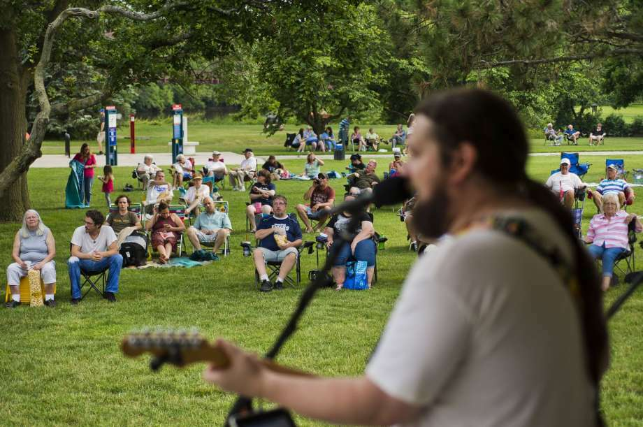 """FILE:Dave Miller, lead singer of mid-Michigan band The Etceteras, sings a cover of """"Stuck in the Middle with You"""" by Stealers Wheel with the rest of his band during Tunes by the Tridge on Thursday in Chippewassee Park."""