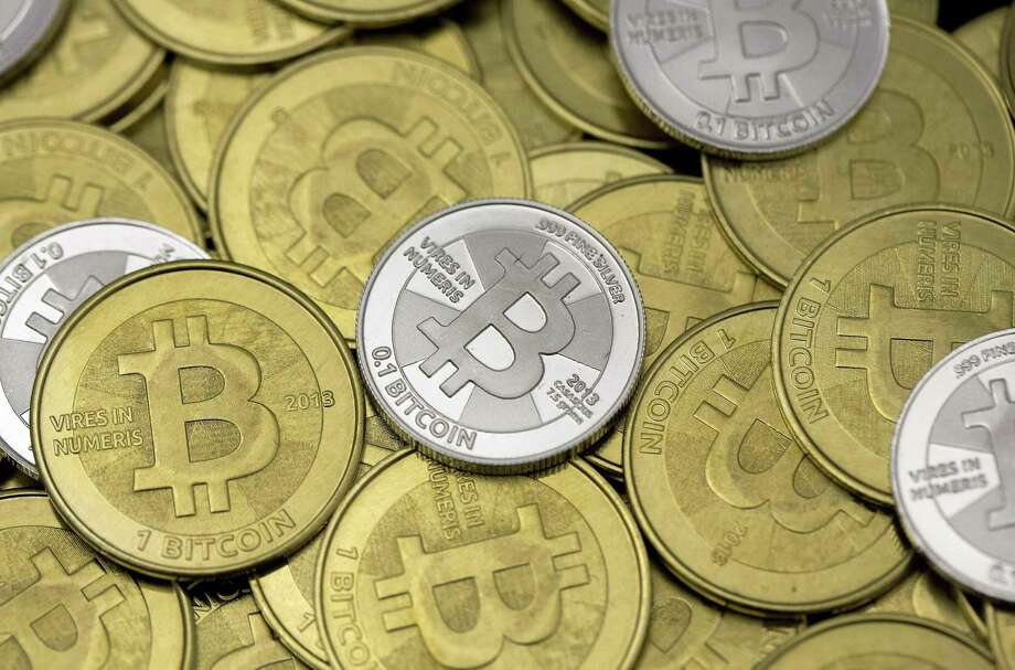 Some of a Bitcoin enthusiast's coins are pictured at his office in this photo illustration in Sandy, Utah, January 31, 2014. The rich have always feared robbery and extortion. Now, big holders of bitcoin and its brethren have become alluring marks for criminals, especially since the prices of virtual currencies entered the stratosphere last year. Photo: JIM URQUHART /Reuters / X02779