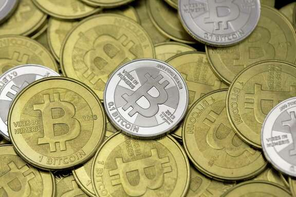 Some of a Bitcoin enthusiast's coins are pictured at his office in this photo illustration in Sandy, Utah, January 31, 2014. The rich have always feared robbery and extortion. Now, big holders of bitcoin and its brethren have become alluring marks for criminals, especially since the prices of virtual currencies entered the stratosphere last year.