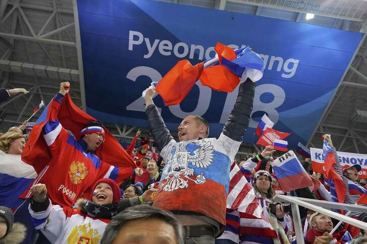 Russian fans celebrate after a goal during a men's hockey preliminary match between the U.S. and the Russian hockey team during the 2018 Winter Olympics at the Gangneung Hockey Centre in Gangneung, South Korea, Feb. 17, 2018. The U.S. lost the match 4-0.  (Chang W. Lee/The New York Times)