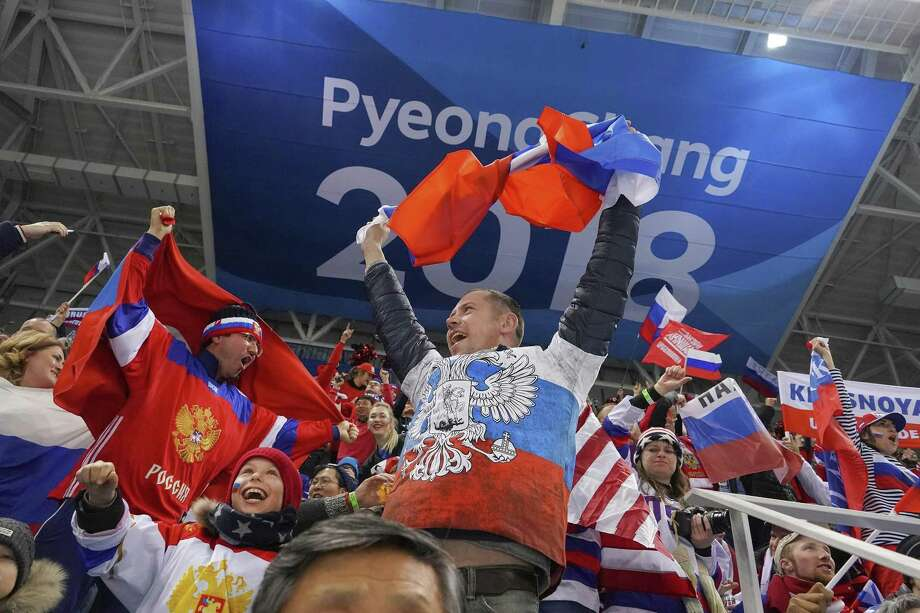 Russian fans celebrate after a goal during a men's hockey preliminary match between the U.S. and the Russian hockey team during the 2018 Winter Olympics at the Gangneung Hockey Centre in Gangneung, South Korea, Feb. 17, 2018. The U.S. lost the match 4-0.  (Chang W. Lee/The New York Times) Photo: CHANG W. LEE, STF / NYT / NYTNS