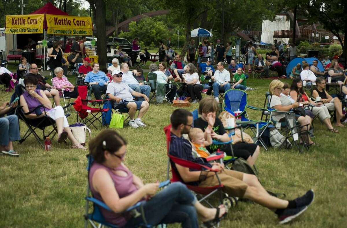 FILE: People wait for music to start during Tunes by the Tridge on Thursday, June 22, 2017 in Chippewassee Park.