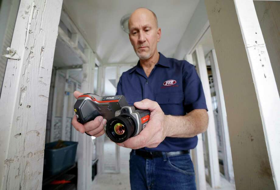 "Gordon Fox, owner of Fox Inspection Group,  uses a thermal imaging camera to check for moisture inside the studs of a Meyerland home. ""If you're not using infrared, you're not using the latest technology,"" he said.  Photo: Michael Wyke, For The Chronicle / © 2018 Houston Chronicle"