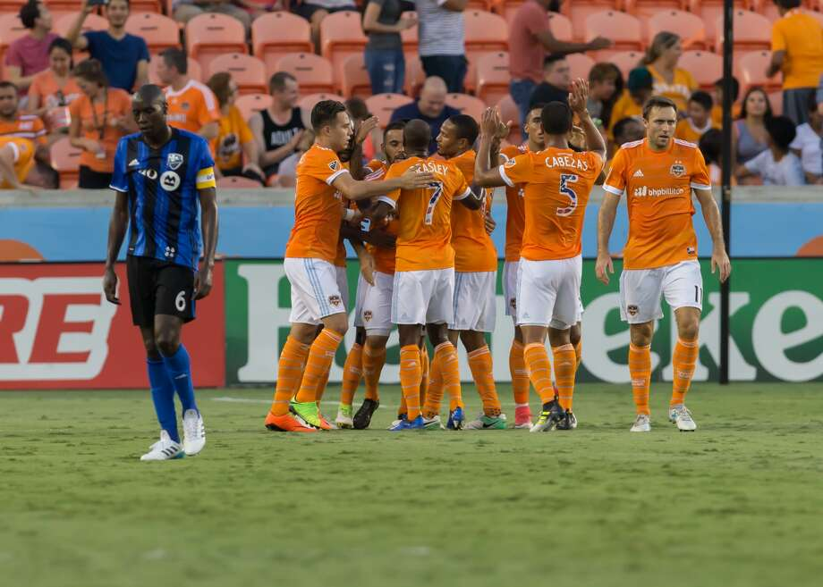 HOUSTON, TX - JULY 05:  Houston Dynamo celebrate a goal scored during the MLS match between the Montreal Impact and Houston Dynamo on July 5, 2017 at BBVA Compass Stadium in Houston, Texas.  (Photo by Leslie Plaza Johnson/Icon Sportswire via Getty Images) Photo: Icon Sportswire/Icon Sportswire Via Getty Images