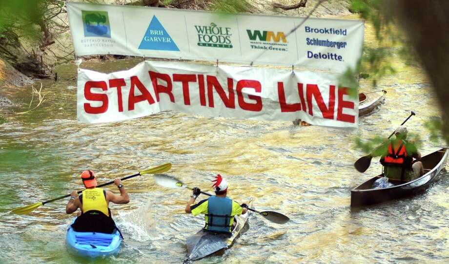 Passing the starting line on their way downtown Saturday during the Buffalo Bayou Regatta. Photo: Rusty Graham / The Examiner