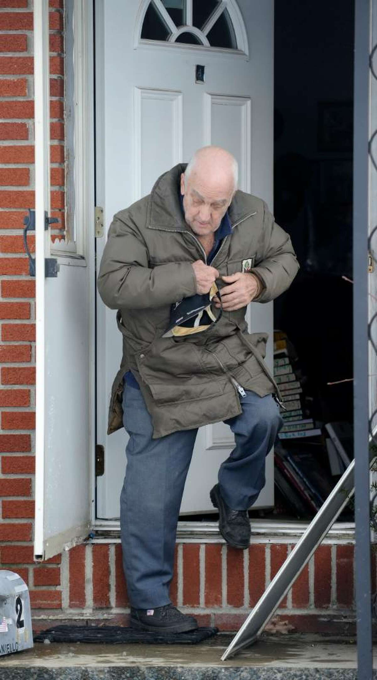 Louis Pisaniello 82, an Alzheimers patient leaves his home at 20 Industrial Park Road in Troy, New York after some urging after the City Marshall called for his eviction December 10, 2009. (Skip Dickstein / Times Union)