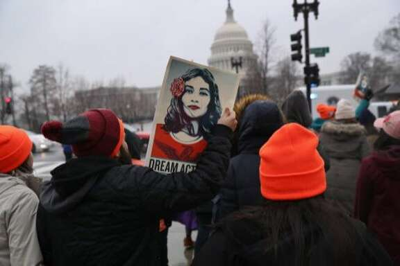 "WASHINGTON, DC - FEBRUARY 07:  Immigration activists march in front of the U.S. Capitol on February 7, 2018 in Washington D.C. A coalition of activists from across the U.S. demonstrated to pressure Congress to pass legislation protecting ""Dreamers"" as part of federal budget negotiations.  (Photo by John Moore/Getty Images,)"