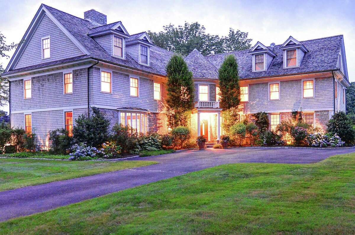 The custom-built stone and cedar colonial house at 2140 Burr Street is on the market for the first time since it was built in 2004. It sits on a corner lot with driveway entrances on Burr Street and Towne House Road.