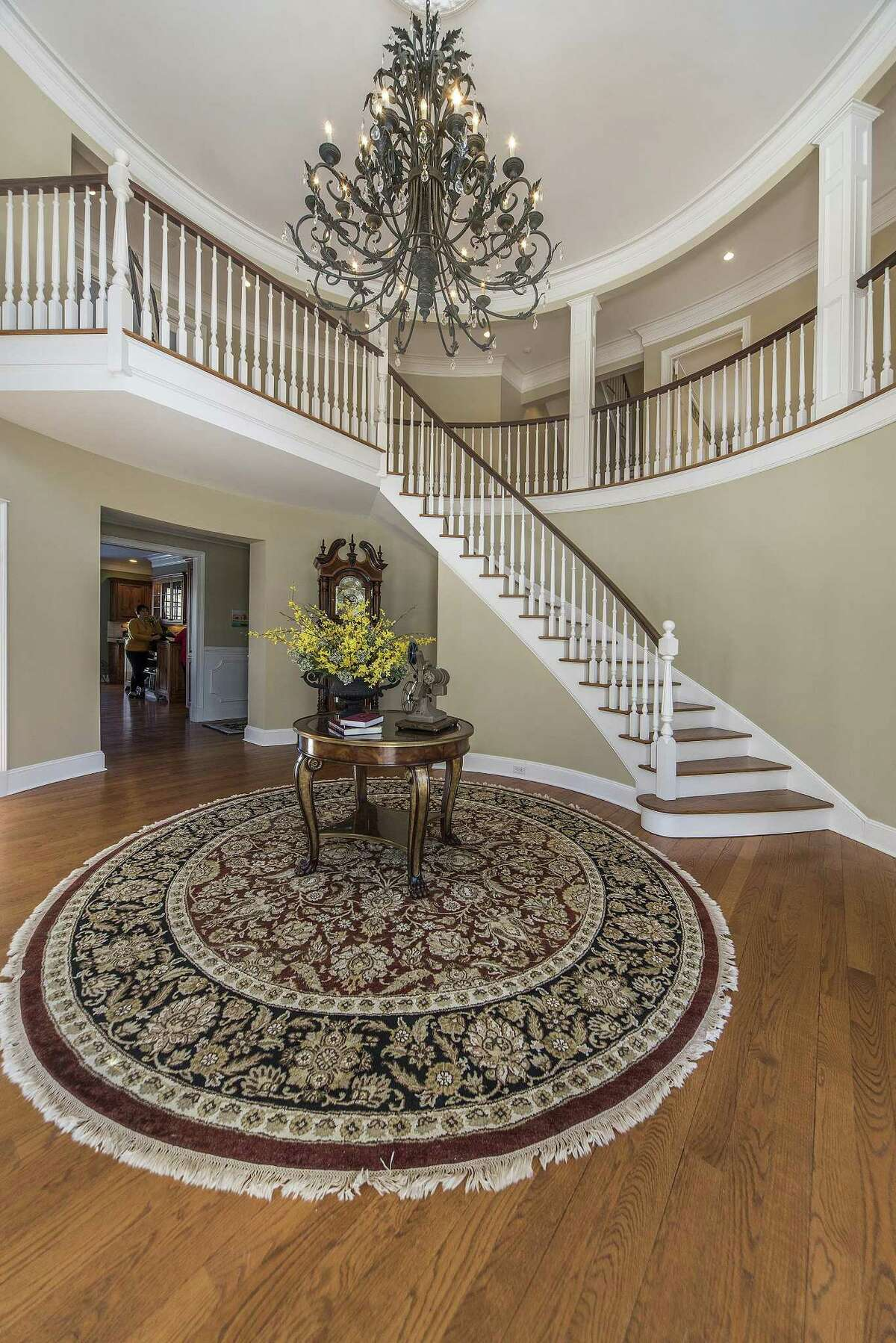 The front door opens to the two-story rounded foyer of this 7,231-square-foot house.