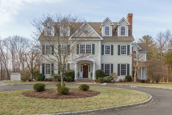 The 13-room colonial house at 16 Raymond Lane has six bedrooms and five fireplaces, including one in the backyard.