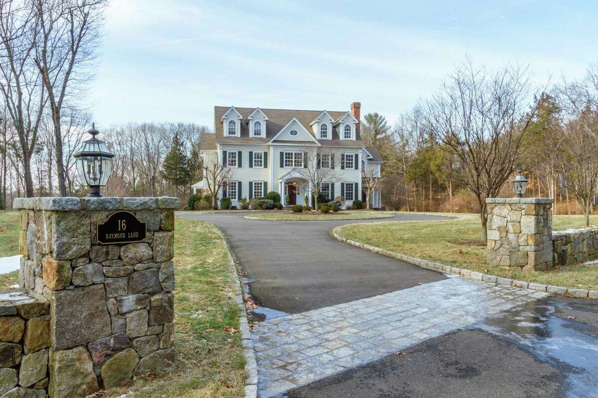Rose Hill Manor at 16 Raymond Lane comprises a 7,754-square-foot colonial house and a 2.55-acre level property close to town and train.