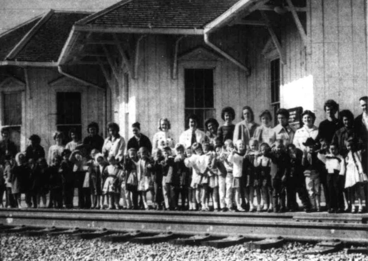 Spring ISD school children stand at the railroad tracks near the Old Conroe Depot in February 1964. The children rode the train back to Spring to learn about trains. The Conroe Depot was destroyed by fire in August 1981.