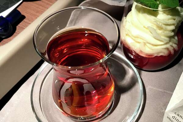 Turkish Airlines business class meals finish with a shapely cup of tea poured from a silver pot and a strawberry parfait-- along with a a flickering LED candle. Classy