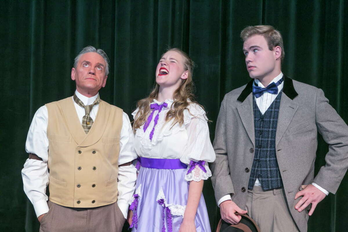 """Horace with weepy niece Ermengarde and Ambrose Kemper. From left to right Michael Martin, Elissa Lynch and Cain Hamilton in Stage Right's """"Hello Dolly!"""" now on stage at the Crighton Theatre through Feb. 25."""
