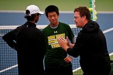 Dow tennis coach Terry Schwartzkopf, right, has been named Division 2 Boys' Tennis Coach of the Year by the Michigan High School Tennis Coaches Association and Boys' Tennis Coach of the Year by the Michigan High School Coaches Association. (Erin Kirkland/Daily News file photo)