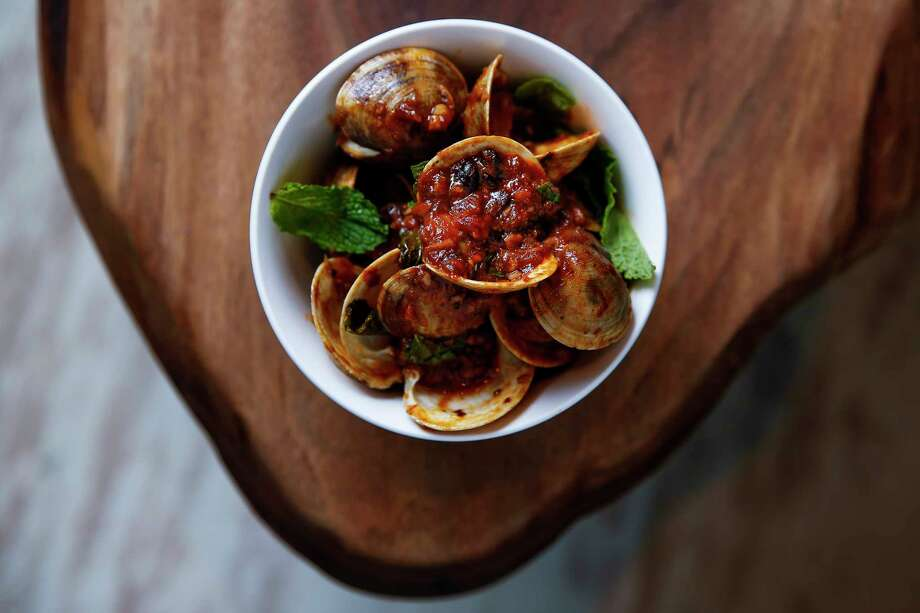 Chef Jacob Pate's inventive menu includes Singapore chili clams. Photo: Michael Ciaglo, Houston Chronicle / Michael Ciaglo