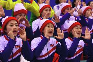 North Korean cheerleaders cheer during the women's preliminary round ice hockey match between Japan and the Unified Korean team during the Pyeongchang 2018 Winter Olympic Games at the Kwandong Hockey Centre in Gangneung on February 14, 2018.   / AFP PHOTO / Jung Yeon-je        (Photo credit should read JUNG YEON-JE/AFP/Getty Images)
