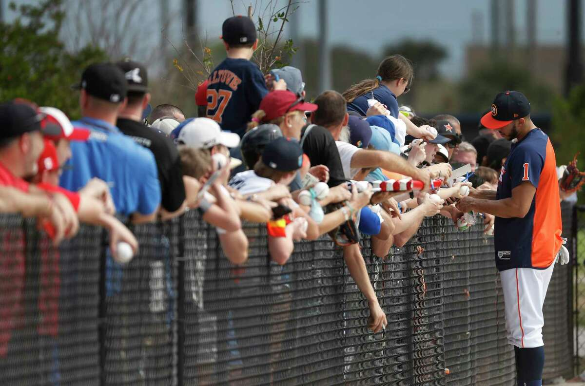 Fans line up to get Houston Astros Carlos Correa's autograph after he finished his workout, as full squad workouts began during spring training day at The Ballpark of the Palm Beaches, Monday, Feb. 19, 2018, in West Palm Beach .