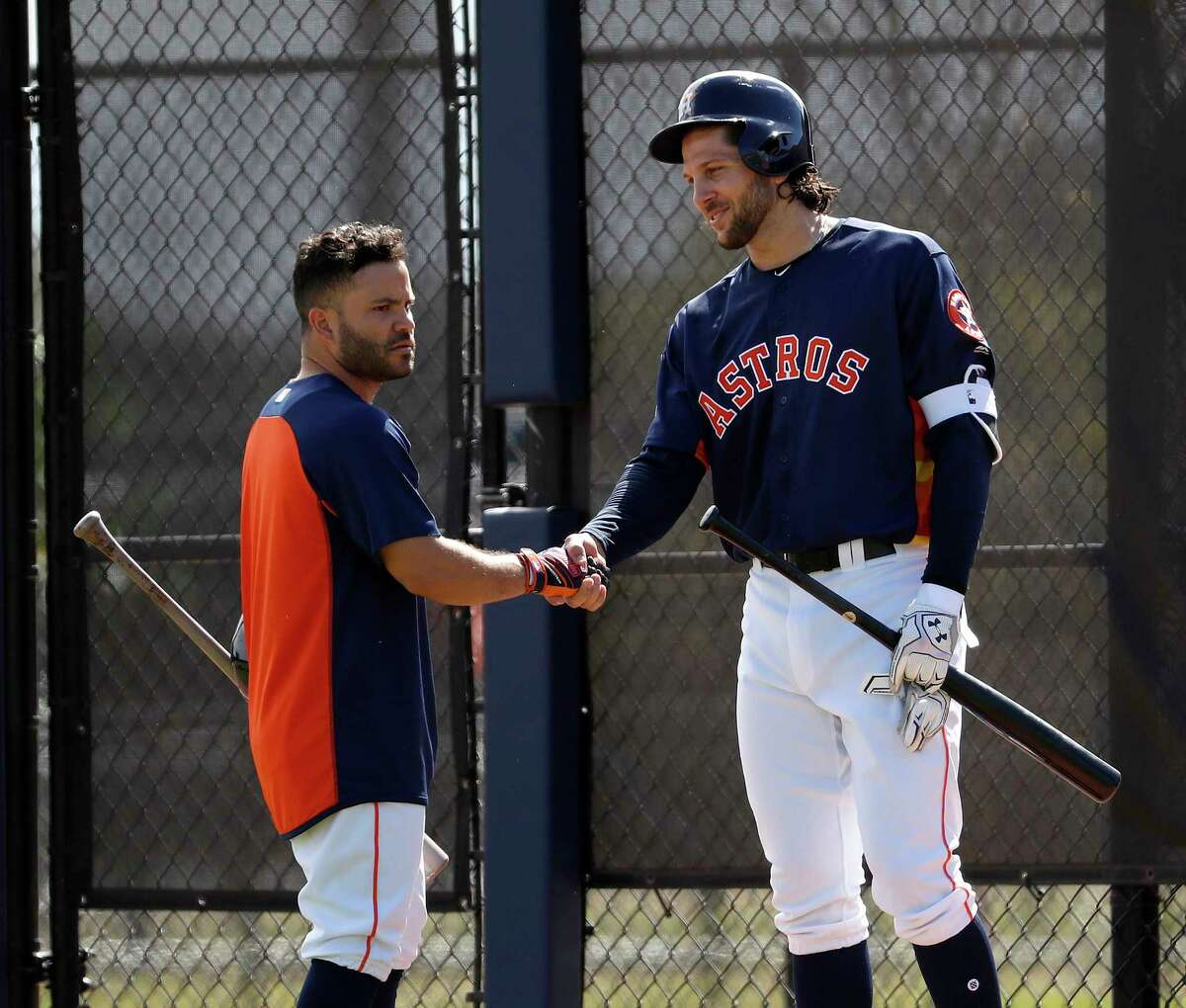 Houston Astros Jake Marisnick (6) shakes hands with Jose Altuve (27) as full squad workouts began during spring training day at The Ballpark of the Palm Beaches, Monday, Feb. 19, 2018, in West Palm Beach .