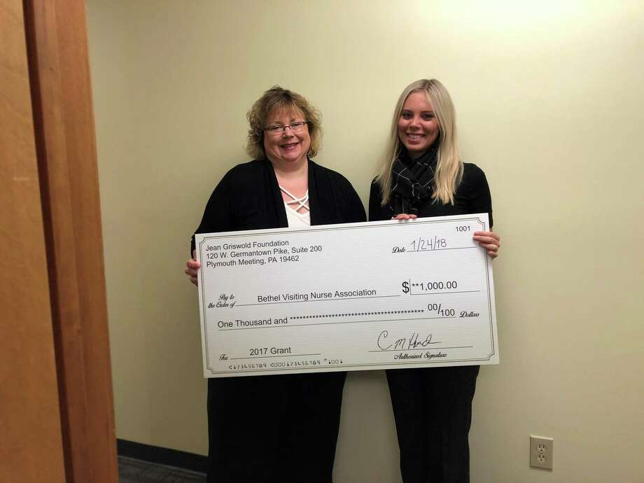 The Bethel Visiting Nurse Association recently received a Jean Griswold Foundation grant for its Telehealth Monitoring Program. Maggie Burke, executive director of the Bethel VNA, (left) and Kelly Coy, case manager at Griswold Home Care, (right) hold the check for the grant. Photo: / Contributed Photo