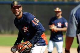 Houston Astros first baseman Yuli Gurriel (10) smiles during a drill as full squad workouts began during spring training day at The Ballpark of the Palm Beaches, Monday, Feb. 19, 2018, in West Palm Beach .