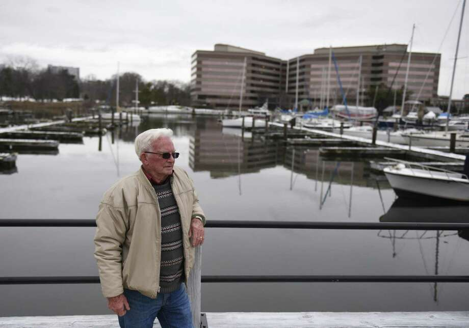 Stamford resident John Gilronan looks out onto the dock where he keeps his boat at Czescik Marina in Stamford, Conn. Monday, Feb. 19, 2018. After nearly two decades of docking his 17-foot boat at the public marina, Gilronan was surprised to hear of a new requirement forcing folks to get a certificate of liability insurance for at least $500,000, and that it had to list the city, its employees, agents and officers as insured. Photo: Tyler Sizemore / Hearst Connecticut Media / Greenwich Time